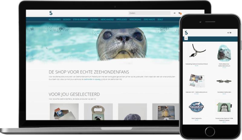 Voorbeeld webshop Zeehondencentrum Pieterburen: homepage op laptop en artikeloverzicht mobiel